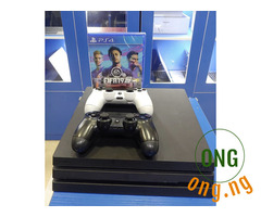 Sony PlayStation (Ps4 Pro 1TB) with two controllers