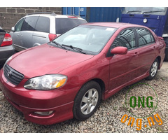 pure red Toyota Corolla for sale